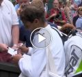 Classy champion: Rafael Nadal signs autographs after loss to Djokovic