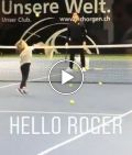 Roger Federer plays tennis with one of his sons